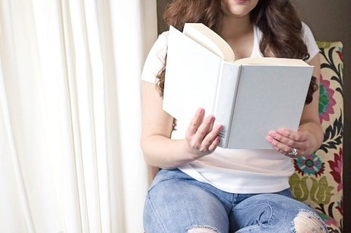 Woman Sitting Reading A Book For Self-Care